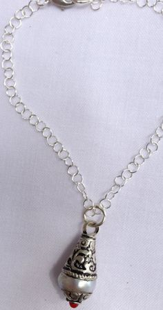 Pearl in silver hold sterling chain.