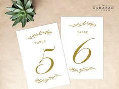 Note from Renee - One of my favorites.  PRINTABLE Table Number Floral DIGITAL Table by littlecarabaostudio