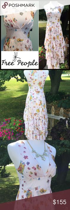 FREE PEOPLE MAXI DRESS Free People gorgeous deep V-neck floral pattern with a wide band at the waist leading to a tiered asymmetric bottom. Lining stops at approximately the mid thigh so the layered bottom flows as you walk. Side zipper. Made of rayon & viscose for a soft flow and a soft satin feel nylon lining. NO LOW OFFERS PLEASE Free People Dresses Maxi