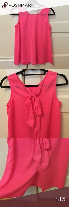JCrew Hot Pink Bow Back Tank Adorable Jcrew hot pink top with a cute bow tie at the back and a small opening at the bottom. Adorable with white jeans! J. Crew Factory Tops Tank Tops