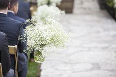 So simple and romantic!   Photo by: Jessica Lynn Hatton Photography.   #ptopofthebluegrass #ptopweddings2016 #weddingflowers #weddingceremony #whiteweddingflowers #babysbreath #distillerywedding #buffalotracedistillery