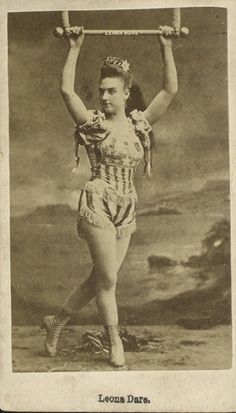 """Leona Dare (1854/55 – May 23/24, 1922[1]) was an American trapeze artist and aerial acrobat, billed often as the """"Queen of the Antilles"""" or the """"Pride of Madrid""""."""