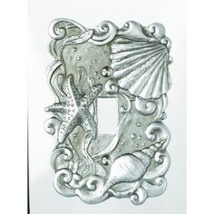 Seashell Light Switch Cover Perfect for any room. Light switch plate is decorated with shells and a starfish and surrounded with ocean waves. 31/2