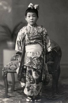 Studio portrait of a young girl in her best silk kimono. About 1910's, Sizuoka, Japan. Image via softypapa of Flickr