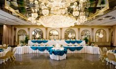 Wow these chandeliers add a touch of major traditional glamour to this wedding reception! {Martin's Caterers}