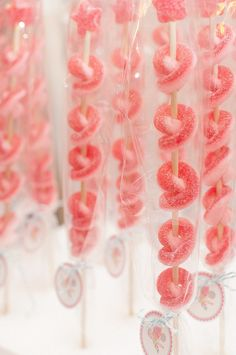 """Sugared pink and red gummy candies (similar to """"peach-os"""") twisted around a skewer and topped with a gumdrop star, wrapped and tied with a birthday tag."""