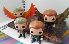The pop squad I made a few months ago for Darklight con (april Paris, France) ! The two with wings were for the autograph sessions and are n. Funko pop custom Gabriel and Lucifer Supernatural Supernatural Merchandise, Supernatural Fans, Pop Custom, Funko Pop, Gabriel, Disney Characters, Fictional Characters, Deviantart, Toys