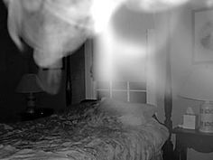 A vaporous mist of ectoplasm floats among the antiques in a bedroom at Oak Alley Plantation in Vacherie. The plantation reportedly is haunted by a female ghost in an antebellum costume. - Louisiana Spirits