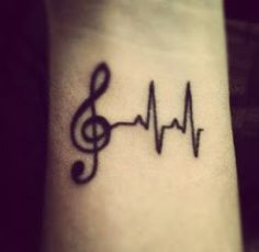 Music Tattoo Designs: girly music tattoos and music note tattoos