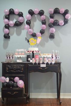 Pink and black balloons at a ready to pop baby shower party! See more party planning ideas at CatchMyParty.com!