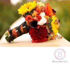 Sunflower bridesmaid bouquet...like would take out the roses
