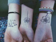 Flower grunge wrist tattoo
