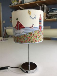 Free motion embroidered lampshade made as a birthday gift - dinghy regatta, the winner approaching the finish line - Freehand Machine Embroidery, Free Motion Embroidery, Free Machine Embroidery, Fabric Art, Fabric Crafts, Lampshade Designs, Lampshade Ideas, Art Deco Lamps, Lamp Shades