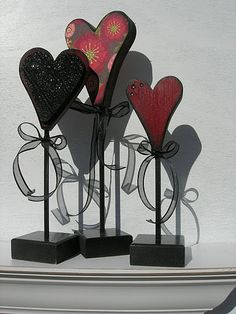 (All prices listed are for unfinished) Large, Medium, Small Heart on base unfinished $4.95,$4.50,$3.95 Bead board attachment on medium heart $0.99. Paint colors: all bases painted black, Small and medium heart: Medocino, Bead board attachment: black. Large heart stained and covered in scrapbook paper using a spray adhesive. all hearts brushed lightly on edges with Black paint. All colors are Delta Ceramcoat.