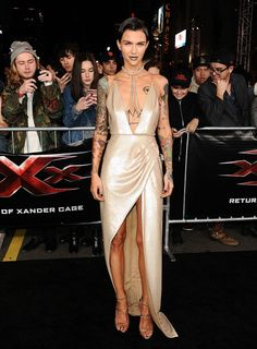 <p>Ruby Rose was giving us strength and femininity in this plunging high-slit Julien McDonald dress and strappy Guiseppe Zanotti heels. The gown's ivory tone contrasted gorgeously against the star's raging tattoos. <i> (Photo: Getty/Jan. 19 2017) </i> </p>