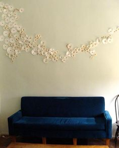 wall flower mural made with cupcake liners and orange thumbtacks.