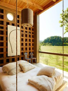 swing bed, minimalist rustic interior with a view.