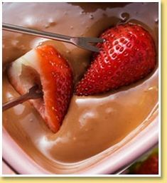 TOBLERONE Fondue with Cointreau. Serve it with strawberries, banana, meringues & marshmallows!!! To die for...