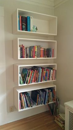 Floating bookshelves, these are bookshelves I like. Looks like you could do this with an IKEA kitchen wall cabinet minus door and turned horizontal to mount.