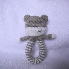 Thank you so much for your interest in my little teddy rattle. Here, at last, is the pattern. As usual, please do not sell this patte. Babyrassel [Free Pattern] This Easy To Make Baby Rattle Is So Adorable! - Knit And Crochet Daily Crochet Teddy Bear Pattern, Crochet Baby Toys, Crochet Diy, Crochet Amigurumi, Amigurumi Patterns, Crochet For Kids, Crochet Dolls, Baby Knitting, Crochet Patterns