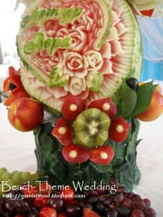 fruit and vegetable  flora arrangements | Watermelon carving details and exotic flower out of kiwi and apple
