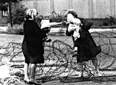 Bidding farewell over the barbed wire, Berlin, Aug. 13, 1961