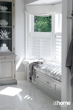 8 Excellent Bay Window Seat Examples for Your Recess Spot At Home in Fairfield County: Elegant gray master bathroom with bay windows and white roman shades. Gray built-in . Bay Window Shutters, Cafe Shutters, Window Frames, Curtains Living Room Bay Window, Blinds For Bay Windows, Living Room With Bay Window, Bay Window Storage, Shutters With Curtains, Bay Window Decor