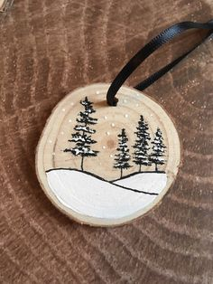 Items similar to Handpainted wood slice ornament black and white winter trees, with ribbon on Etsy Hand painted wood slice ornament. Black and white. Measures approx 2 inches in diameter. Painted Ornaments, Wooden Ornaments, Christmas Wood, Diy Christmas Ornaments, Christmas Coasters, Xmas, Winter Painting, Painting On Wood, Wood Slice Crafts