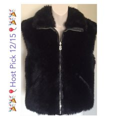 """♣HP️ BOGNER reversible vegan faux fur vest❤️ This is a gorgeous BOGNER faux fur vest. Reversible and has pockets on both sides. Bust  40"""" waist 40"""" length 23"""". Worn once. Silver hardware.   All items are from a clean, smoke free home  We ❤️ offers but will only be considered by using the """"OFFER"""" option  Trades  Modeling Bogner Jackets & Coats Vests"""
