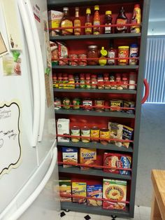 Roll out shelf beside refrigerator allowing space for refrigerator doors to open.