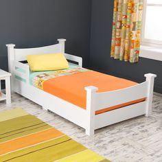 Tuck your little one in for a night of sweet dreams with this classically designed toddler bed. A sleek, streamlined style matches your existing decor to help ease the big step from crib to grown-up bed.