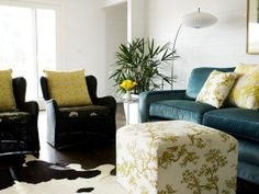 blue velvet couches with black chairs