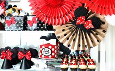 Dessert Table: When decorating for a party I find that grouping themed items create more of an impact rather than spreading them throughout your space.  I choose to take over our hutch and make that Mickey and Minnie central! Kristin says. Source: The Hunted Interior