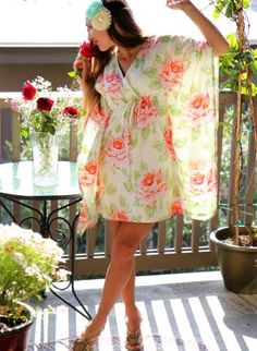 """""""Pretty & Romantic Roses an Cream Mini MuuMuu Hawaiian Dress. Really lovely for a weekend in Hawaii! If only!"""".....Um, not so much. I'm in Hawaii now and it's cold, raining and miserable. Can't wait to leave!"""