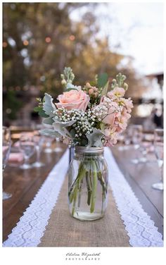 Centerpieces of roses, stock, hypericum, dusty miller, babies breath and eucalyptus