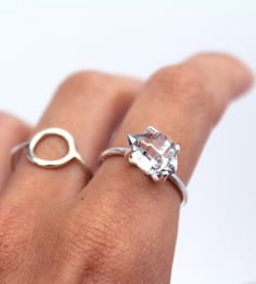 This elegant sterling silver ring sports a rough-cut 9-10 mm. Herkimer diamond at the helm. It makes for a spectacular statement piece, but pairs well with others too. Wear. Grin. Repeat.