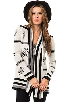 The Rolly Patterned Cardigan by BB Dakota. Layer up in this cozy sweater by BB Dakota.  $84