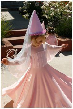 girl spinning in pink Appleblossom dress