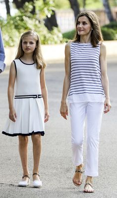 Queen Letizia does European casual well, too – here she is in summery white pants and a striped white and navy top with her daughter, Princess Leonor.