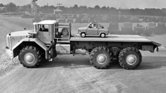 """""""The French Berliet T100 was the largest truck in the world in 1957. The Vespa 400, on the other hand, was an Italian bubble car also produced in France. Putting them together still looks like a fun afternoon."""""""