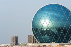 Aldar, a real estate development and investment company in Abu Dhabi, exists to turn a profit. True to form, its futuristic HQ resembles a giant coin. Inside, 12 high-speed elevators help employees move up 23 floors that include office spaces, two cafés, prayer rooms and male and female gyms. The world's first circular skyscraper, it's held together by a diagonal grid of steel.