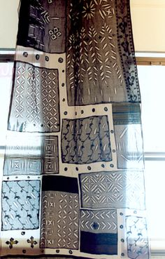 Idea for curtains inspired by this - take scarves and sew onto sheer curtains for something different