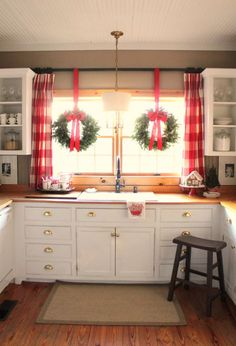 Buffalo check curtains add to the holiday charm and character of this festive farmhouse kitchen!