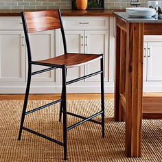 Studio Bar Stool + Counter Stool #WestElm -we could keep the table we have but update the look by buying new bar stools, maybe a few of these on the ends, and some swivel stools on the sides...