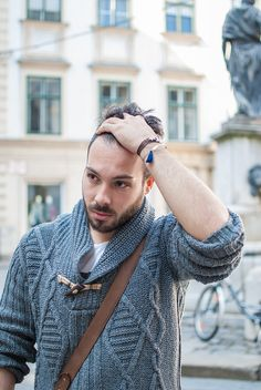 Handsome bearded guy wearing a knitted grey sweater and jewelry for men - leather wristband silver tassel armchain - beard Leather Wristbands, Grey Sweater, Daniel Wellington, Leather Men, Tassel, Handsome, Guys, People, Sweaters
