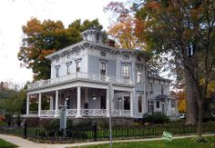 check out this impressive Italianate Home in Allegan, Michigan that was built in 1863 and today is the DeLano Inn Bed & Breakfast. This place is a feast for they eyes & we really like that wrought iron fence.