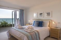 Sand Waves is a luxury self catering holiday apartment at Carbis Beach Apartments in Carbis Bay, Cornwall from Carbis Bay Holidays. Decor, Furniture, Sand, Apartment, Home Decor, Beach Apartment, Holiday Apartments, Bed, Bedroom