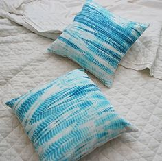 Aqua Shibori Tie Dye Accent Pillow. We are so excited to have sourced this wonderful accent for your home. The fabric from which it was made is hand dyed in India, using an ancient Japanese form of tie dye dating back to the 8th century called Shibori. Bring a bit of the world into your own home with our collection of Global Eclectic pillows. FEATURES - Hidden Zipper enclosure along seam - We selected a soft organic cotton backing that complements the vintage fabric. Please keep in mind…