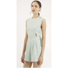 HP[topshop] cut-out romper Soft mint pastel and cut-out shapes keep the romper on point. This style is tailored at the waist for a fitted look and includes a belt. Fastens with a zip at the back. 100% Polyester. Labeled Petite 2. Excellent condition Topshop Other