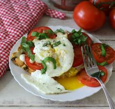 Caprese Egg Sandwich - A light Italian sandwich topped with melted mozzarella cheese, fresh tomatoes a fried egg and basil.